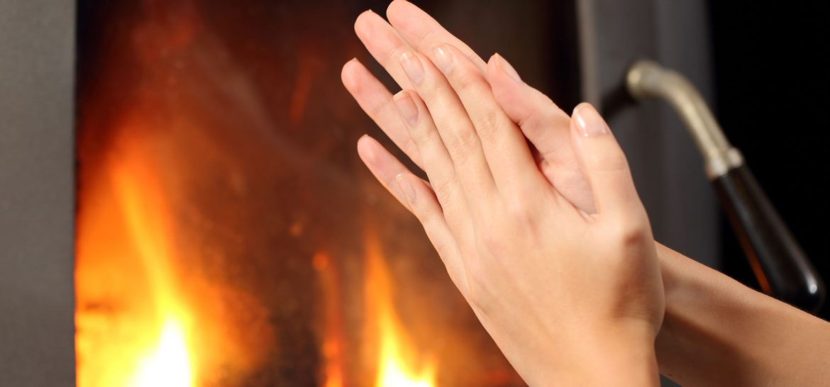 b60a6-woman-hands-heating-in-front-a-fire-place-reducedsize